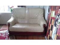 3 piece cream leather suite, with wood base