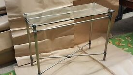 Decorative metal console table with glass top