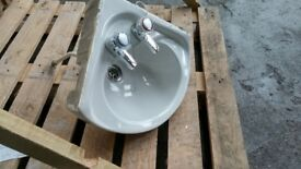 Small corner basin with taps