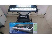 ** Casio LK-120AD Key Lighting Keyboard (inc stand, stool, microphone and original packaging) **