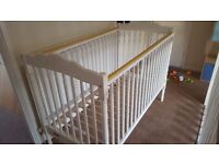 White cot with drop down side and matrass