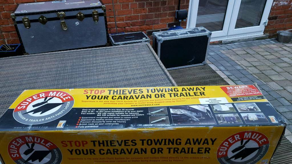 Caraven & trailer new in box Super mule anti theft sysyem gold award sale price bottom of add