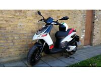 Aprilia SR Motard 125 2014 with helmet