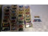 34 Lledo model cars/vans/lorries with display cases