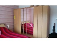 Nolte bedroom freestanding wardrobe with Bi Fold Doors + chest of draws and small chest cupboard