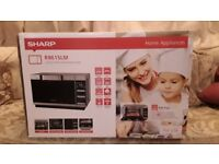 Nearly new sharp r861slm convection combination microwave oven boxed