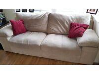 Two beige velour 3 seater sofas