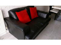 Leather 2 Seater Sofa great condition only 18 months old hardly used, selling due to move