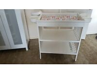 White baby changing unit with storage space
