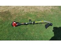 Strimmer petrol lawn king multi tool comes with strimmer head only used twice bargain