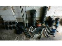 400kg worth of cast iron weights + barbells + dumbbell bars