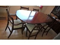 dining table and chairs and various cabinets