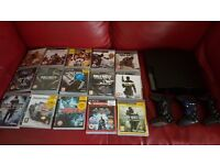 Ps3 with 3 controls and 15 games £130