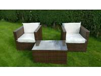 Rattan garden set 2 chairs and a glass top table