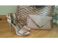 Never worn heels and matching clutch