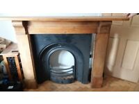 Cast iron fire front and wood surround. Vintage