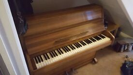 Attractive Upright Family Piano. 6 Octaves. Light Oak.