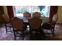 6 seater wooden dining table and 6 chairs