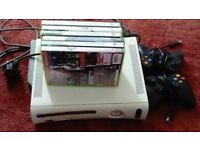 Xbox 360 with 2 🎮 and 6 games as shown
