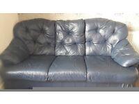 A navy blue leather 3+1+1 sofa suit