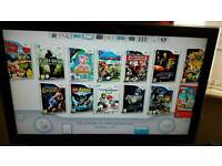 Nintendo Wii with 26 games