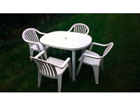 Garden table and four chairs, white plastic