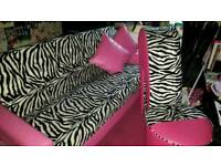 Sofa bed and stiletto chair to match zebra print and pink faux leather.