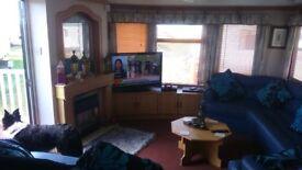 BARGAIN BREAKS ... SANDYLANDS ... 3 BEDROOM FAMILY CARAVAN ...£75. SECURITY ..