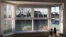 Wood slatted blinds in brown wood
