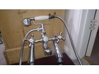 Traditional mixer taps with shower hose attachment