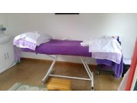 Treatment bed currently used for reflexology and reiki sessions