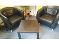 Leather effect tub chairs.