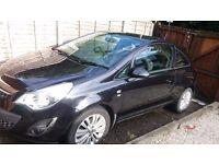 2011 BLACK Vauxhall CORSA - 1.2L petrol. 3dr. **£2900**