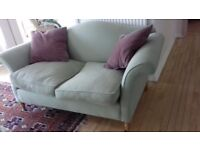 Pale Green Chesterfield Sofa with two purple scatter cushions