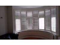 URGENT: Complete set of white shutters for a bay window 7 panels £75 - MUST SELL SOON