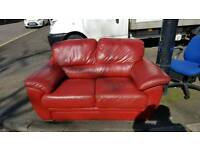 Lovely red Italian leather 2 seater sofa.