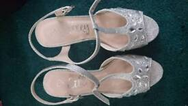 Girls size 3 silver shoes with 2 inch heel, worn once only, very good condition