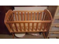 Swinging Baby Crib.