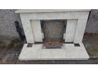 Marble fireplace surround, hearth and plinth..Cream