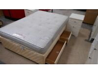 slumberland double 4 drawer bed with a sprung base, and a very firm mattress. excellent. can deliver