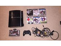 PS3 with games and 2 none official controls