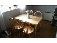 Wooden table with chairs in good condition