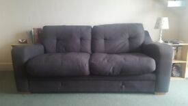 SOLD Grey two seater sofa.