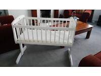 Beautiful solid wood crib . White with rocking system. Includes mattress