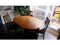 sale table and 4 chairs. the price of 30 pounds. in good condition only a small abrasion.