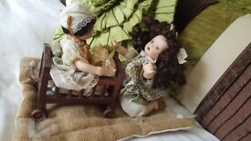 MOVING PORCELAIN DOLLS LITTLE GIRL WITH HER BABY DOLL IN THE COT