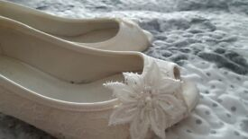 Beautiful wedding dress and bridesmaid dresses shoes to match and veil