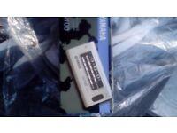 Yamaha Yt 100 guitar tuner. In a box