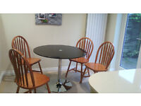 John Lewis small round glass dining table good condition - free if you can collect it