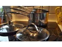 stainless steel set of 3 pans with glass lids